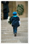 Boy runs up to place flowers at the Ataturk grave